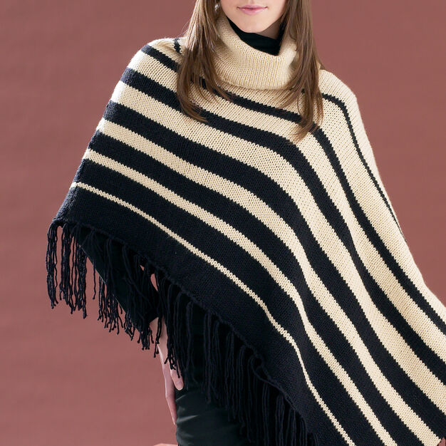 Asymmetrical Striped Poncho in worsted weight yarn.