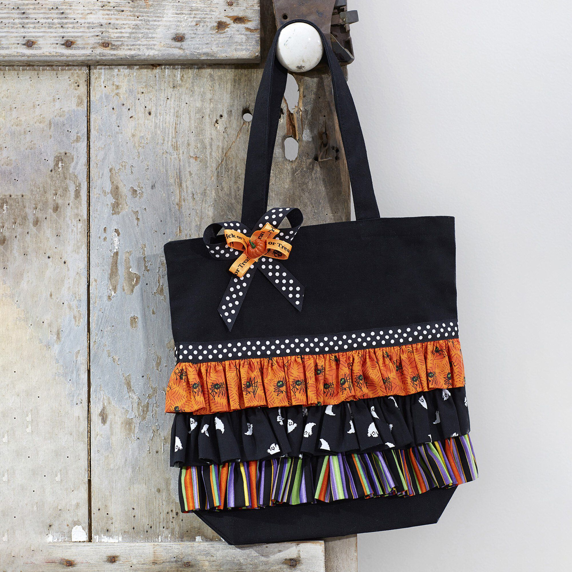 DUAL DUTY RUFFLED TRICK-OR-TREAT TOTE