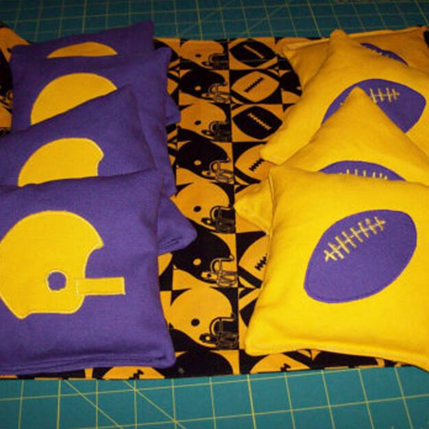 Dual Duty Football Cornhole Bags, Yellow in color