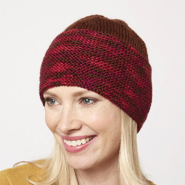 red knit beanie pattern in the round using Caron Simply Soft Solids and Paints yarn in worsted weight.
