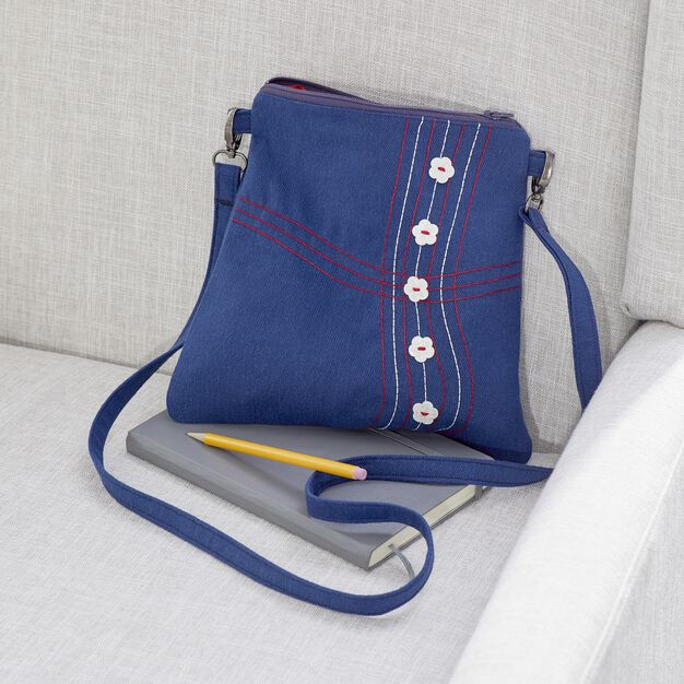 Dual Duty Button and Bobbin Bag uses reverse bobbin work in color