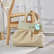 Go to Product: Dual Duty Made in the Suede Tote with optional tassel or pompom in color