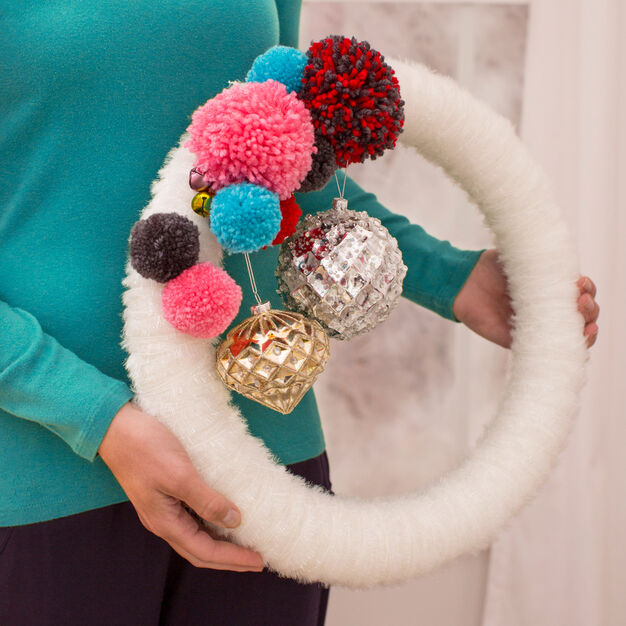 Red Heart Sparkle-Wrapped Pompom Wreath in color