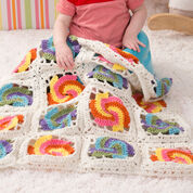 Go to Product: Red Heart Pinwheel Baby Blanket in color