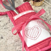 Go to Product: Dual Duty Stir in the Love Potholder in color