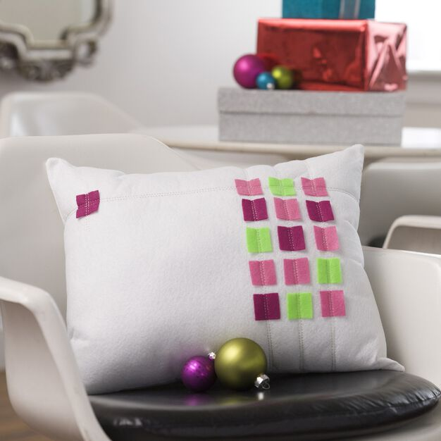 Dual Duty On the Grid Holiday pillow in color
