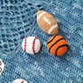 Red Heart Young Athlete Blanket and Rattles in color  Thumbnail Main Image 3}
