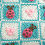 Red Heart Bugs and Blooms Blanket in color