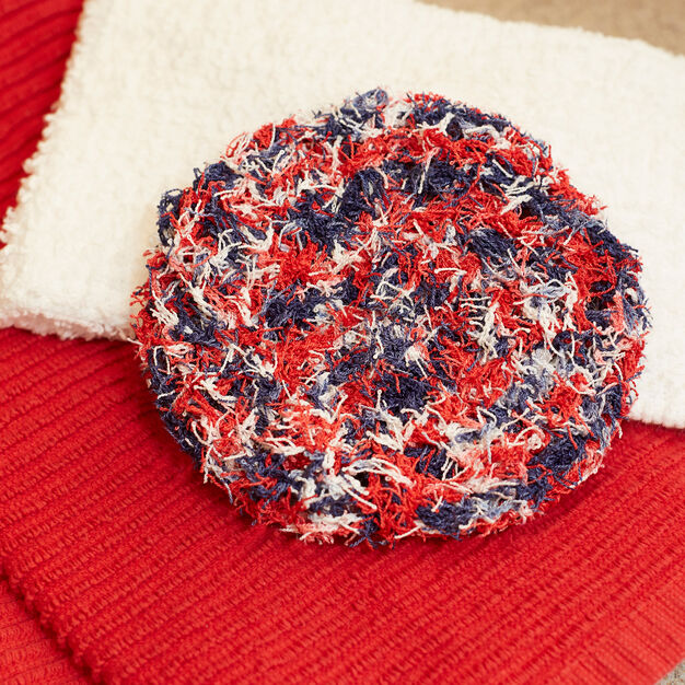 Red Heart Swirl Scrubby in color