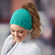 "Go to Product: Red Heart Messy Bun Knit Hat, 18"" in color"