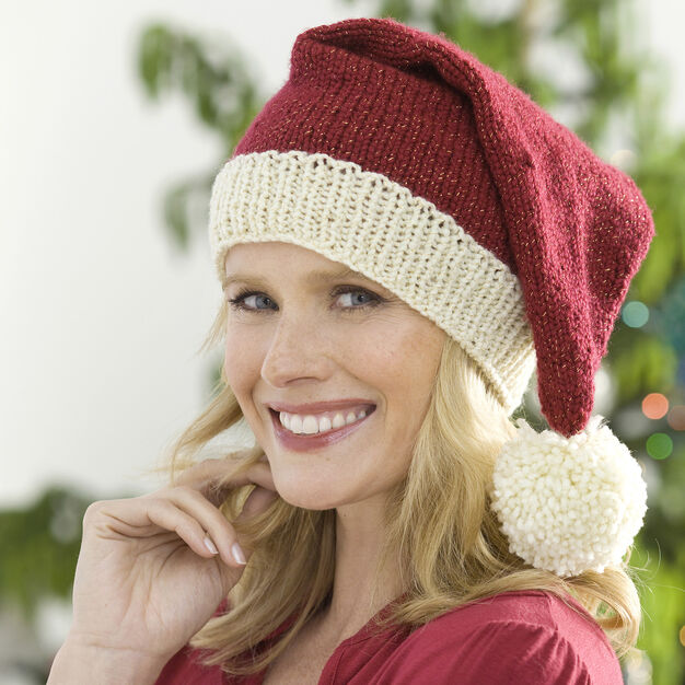 Red Heart Knit Santa Hat, S/M in color