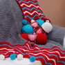 Red Heart Dashing Holiday Throw in color  Thumbnail Main Image 1}