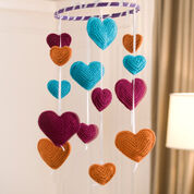 Go to Product: Red Heart Flying Hearts Mobile in color