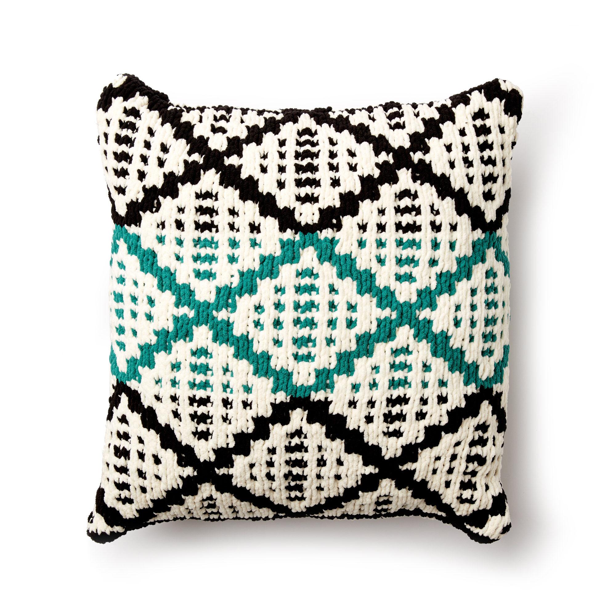 Diamond slip stitch pattern on plush cushion.