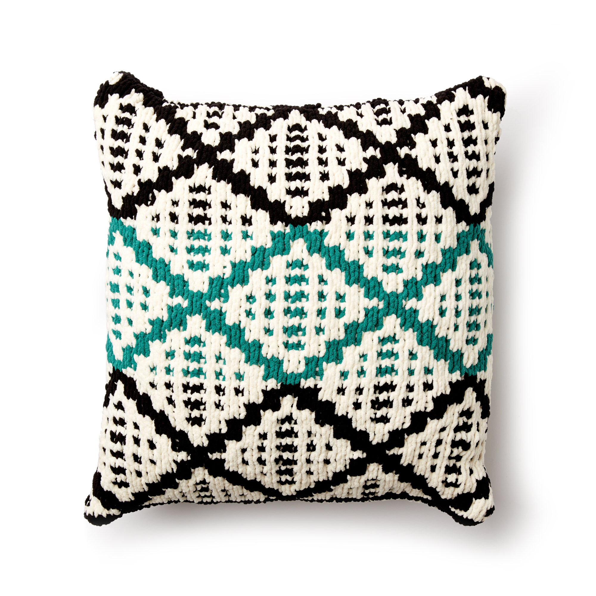 Diamond slip stitch pattern on plush cushion.