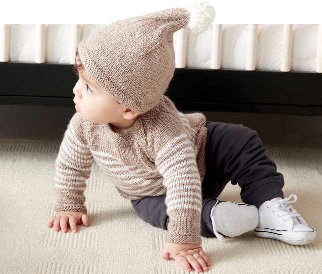 Baby wearing cardigan and hat
