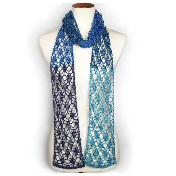 Red Heart One Skein Diamond Lace Scarf in dark blue, royal blue and sky blue contrast is wrapped around mannequin neck