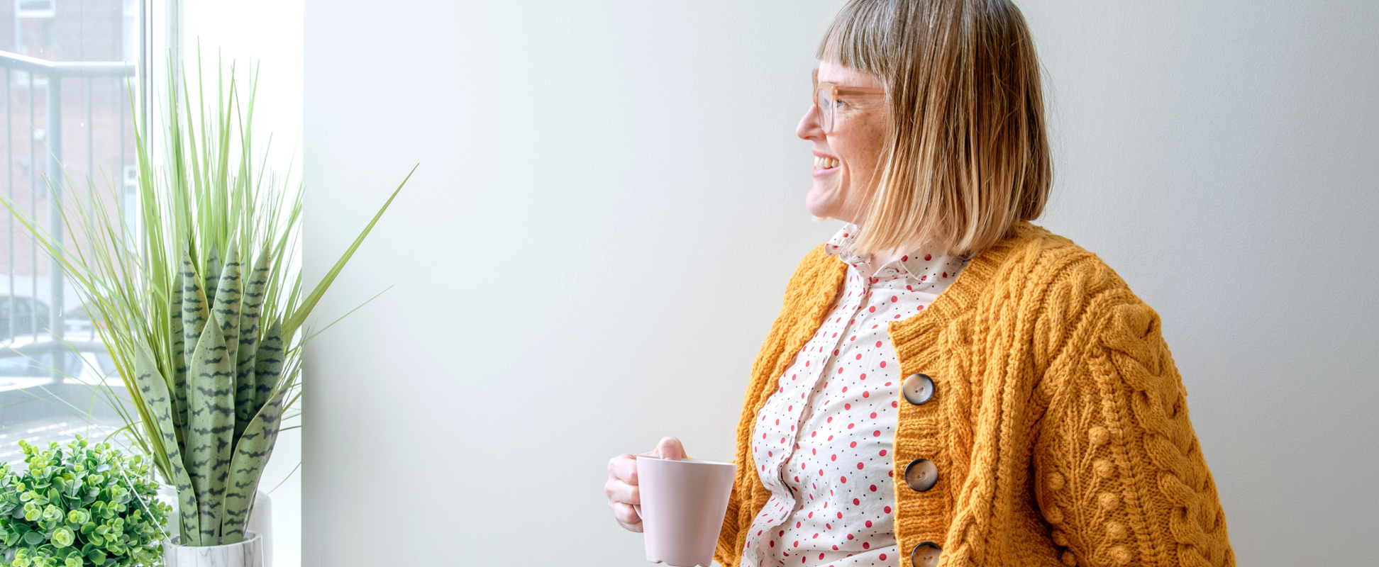 Yarnspirations designer Nicole Winer, wearing the Dovercourt Cardigan knit pattern