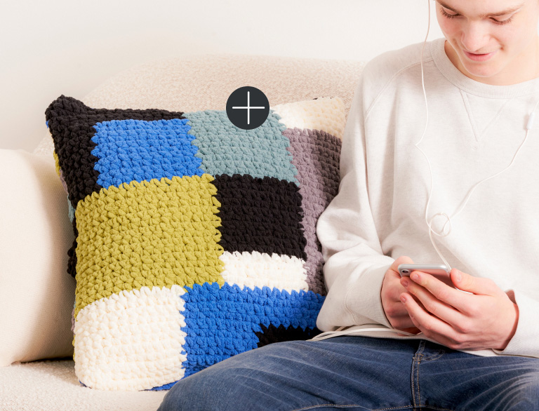 image of Bernat Blocked Out Crochet Pillow Blanket