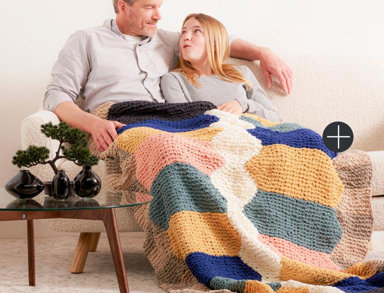 image of Bernat Hexa Lines Knit Blanket Blanket