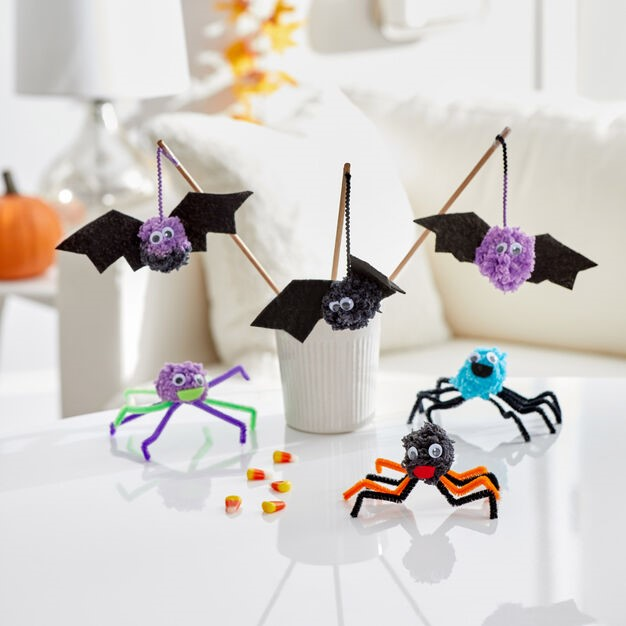 Three Pompom monster and three pompom bats are placed on the table