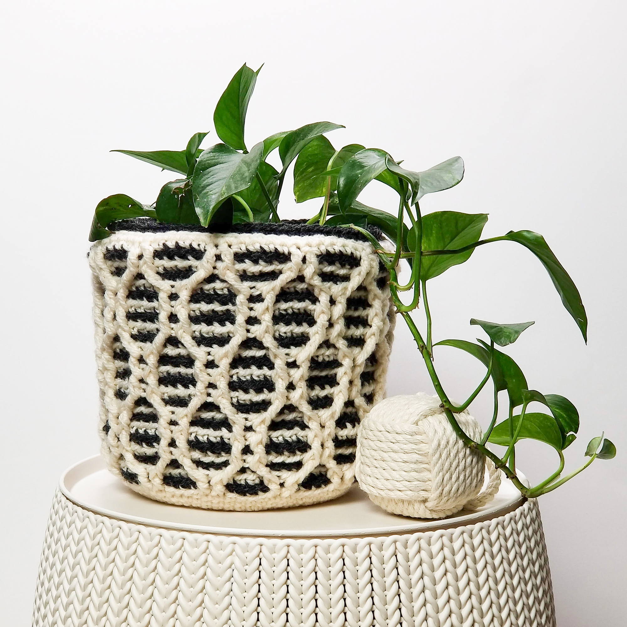 Patons Striped Hourglass Basket in black and cream color