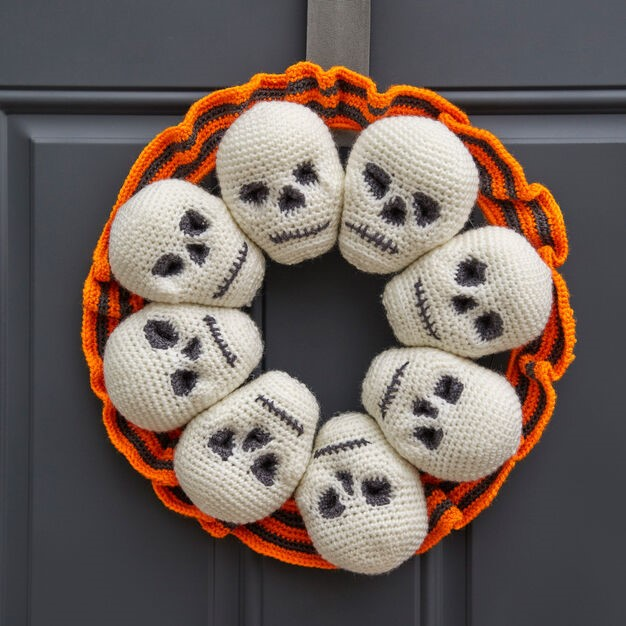 Halloween Circle Of Skulls Wreath hanged on the door
