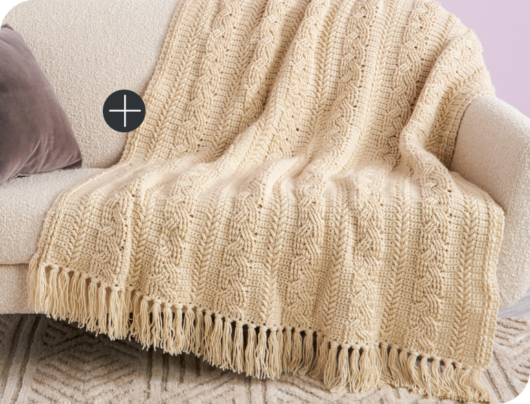image of Caron Braided Cable Crochet Blanket