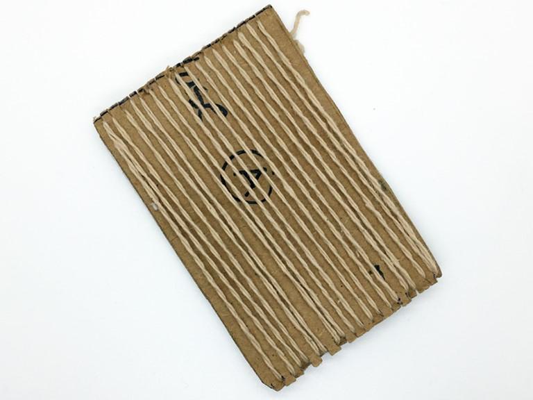 Photo of pattern knitting starts on cardboard step:1
