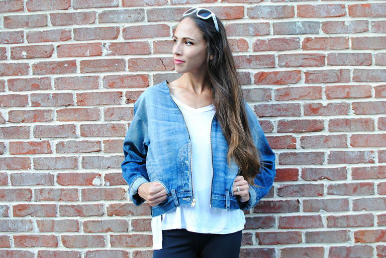 photo of a girl wearing a denim jacket photo