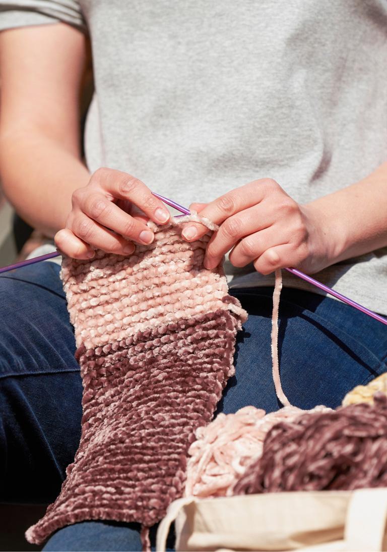 image of women knitting blanket