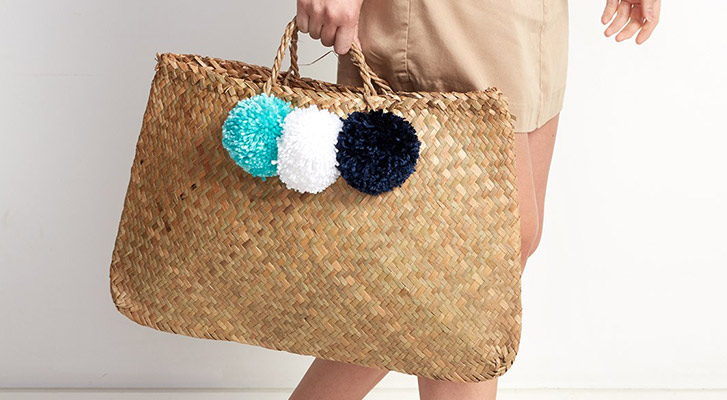 Adding Pompoms to a Straw Bag