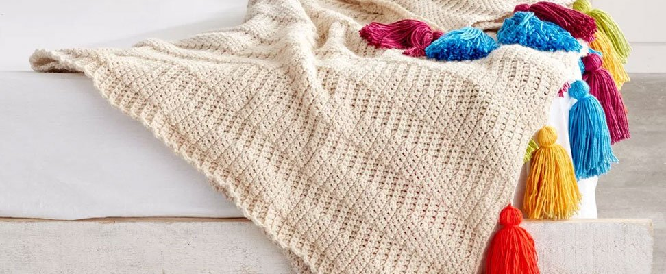 A Chic Crochet Tasseled Throw
