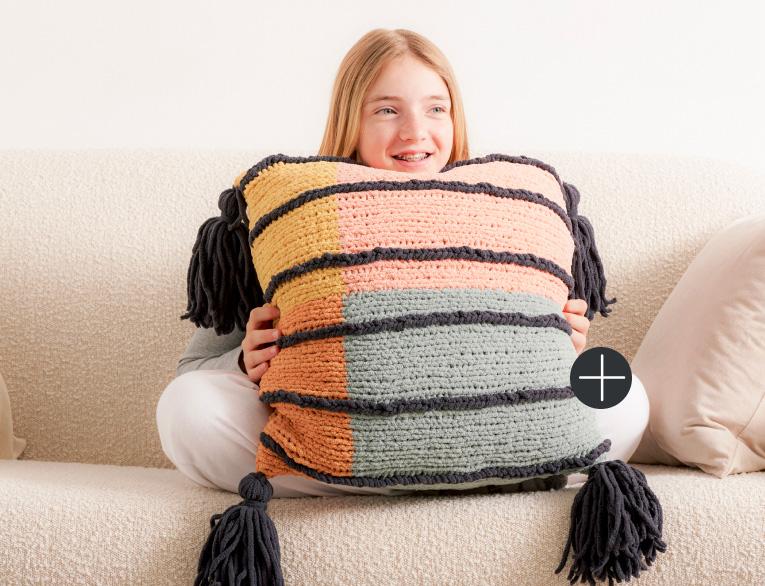 image of Bernat Modern Art Knit Pillow Blanket